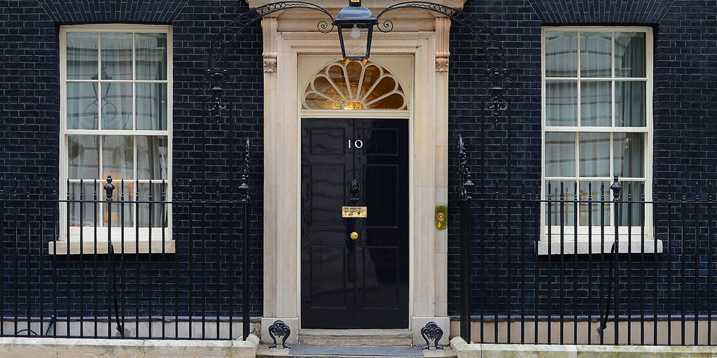 Photo: Number 10 Downing Street, by Sergeant Tom Robinson RLC/MOD Photo: Sergeant Tom Robinson RLC/MOD, OGL v1.0  via Wikimedia Commons https://upload.wikimedia.org/wikipedia/commons/1/13/10_Downing_Street._MOD_45155532.jpg