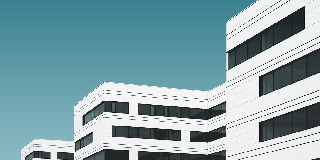 white buildings in a row, source: samuel-scalzo-760410-unsplash
