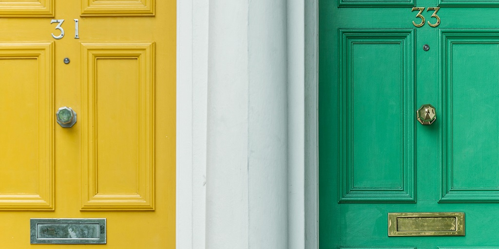 front doors of houses, source: christian-stahl-8S96OpxSlvg-unsplash