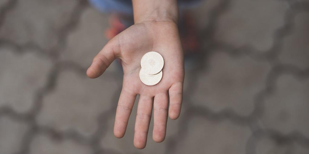 hand holding coins, source: jordan-rowland-716475-unsplash